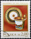 A Stamp printed in Poland shows antique Faience — Stock Photo