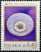 A stamp printed in Poland shows Ancient porcelain plate — Stockfoto
