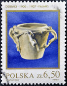 A stamp printed in Poland shows Polish pottery — Stock Photo