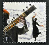 A stamp printed in Great Britain dedicated to sounds of Britain shows Bollywood and Bhangra — Foto Stock