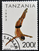 A stamp printed in Tanzania shows diving — Stock Photo