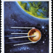 CUBA - CIRCA 1967: A stamp printed in Cuba shows flight of first soviet spaceship Sputnik, circa 1967 — Lizenzfreies Foto