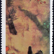 图库照片: RAS AL KHAIM- CIRC1970: stamp printed in Ras-Al-Khaim(United Arab Emirates) shows bound lane by F. Roshu, circ1970.