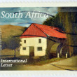 REPUBLIC OF SOUTH AFRICA - CIRCA 2007: A stamp printed in RSA shows a watercolor painting of a windmill in Stoffberg, Mpumalanga, circa 2007 — Stock Photo