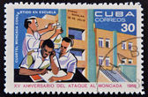 CUBA - CIRCA 1968: Stamp printed in Cuba dedicated to anniversary of the attack on the Moncada Barracks, shows Moncada become school, circa 1968 — Stock Photo