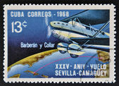 CUBA - CIRCA 1968: A stamp printed in Cuba dedicated to Anniversary of Flight Sevilla - Camaguey by Barberán and Collar, circa 1968 — Stock Photo