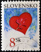 SLOVAKIA - CIRCA 2004: A stamp printed in Slovakia shows a poppy on a red heart, circa 2004 — Φωτογραφία Αρχείου
