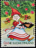FINLAND - CIRCA 2003: A stamp printed in Finland shows Fairy Christmas with gingerbread heart shape, circa 2003 — Stok fotoğraf