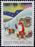 FINLAND - CIRCA 1999: stamp printed in Finland shows Santa with his Sleigh, circa 1999 — Foto Stock
