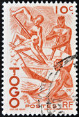 TOGO - CIRCA 1950: stamp printed in France shows four natives at work, Togo, circa 1950. — Stock Photo