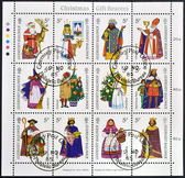 GUERNSEY - CIRCA 1985: Collection stamps printed in Guernsey shows gift bearers, circa 1985 — Stock Photo