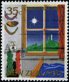 NEW ZEALAND - CIRCA 1989: A stamp printed in New Zeland shows image of a bedroom with fireplace and window on Christmas, circa 1989 — Stock Photo