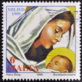 MALTA - CIRCA 1999: A stamp printed in Malta shows the Virgin Mary holding the Baby Jesus, circa 1999. — Stock Photo