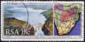 SOUTH AFRICA - CIRCA 1990: A stamp printed in RSA dedicated to hydroelectric cooperation in Southern Africa shows landscapes and maps, circa 1990. — Stock Photo