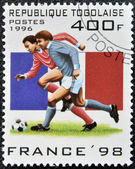TOGO - CIRCA 1996: A stamp printed in Togo dedicated to Soccer World Championship of France 1998, circa 1996 — Stock Photo