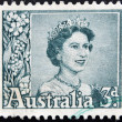 A stamp printed in Australia shows Queen Elizabeth II - Foto Stock