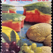 A stamp printed in Australia shows image of a spread of mouth watering fruit - Foto Stock