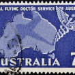 A stamp printed in Australia shows Royal Flying Doctor Service of Australia, Caduceus and Map of Australia - Foto Stock
