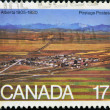 A stamp printed in Canada shows Strip mining and town, Alberta - Foto Stock