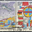 A stamp printed in Czechoslovakia dedicated to Soviet Intercosmos program shows orbital station and flag — Stock Photo #14695757