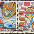 A stamp printed in Czechoslovakia dedicated to Soviet Intercosmos program shows orbital station and flag — Stock Photo