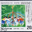 A stamp printed in DPR North Korea shows celebrating spring with May Pole — Stock Photo #14695789
