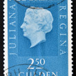A stamp printed in the Netherlands showing a portrait of Queen Juliana - Stock Photo