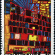 A stamp printed in Luxembourg shows the House with the Arcades and the Yellow Tower by Hundertwasser — Stock Photo