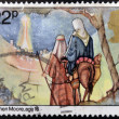图库照片: Stamp printed Christmas in Great Britain shows image of Joseph Childrens and Mary Arriving in Bethlehem