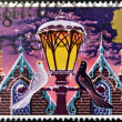 Foto Stock: A christmas stamp printed in Grat Britain shows 'Light of Christmas' (street lamp)