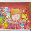 A stamp printed in Great Britain dedicated to Christmas, shows Child reading — Stock Photo