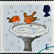 A stamp printed in England, is dedicated to Christmas, shows Robins skating on Bird Bath — Photo
