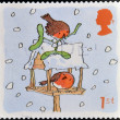 A stamp printed in England, is dedicated to Christmas, shows Robins on Bird Table — Stock Photo
