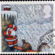 Stock Photo: Stamp printed in Great Britain shows image of SantClaus, Sheltering from Hailstorm behind Chimney