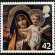 图库照片: Stamp printed in United Kingdom shows Virgin mary with Infant Christ