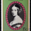 Stock Photo: Stamp printed in St. Vincent shows portrait of Queen Victoria, 40th anniversary of Queen Elizabeth II and 150th anniversary of Queen Victoria