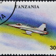 A stamp printed in Tanzania shows Tactical Jet Fighter F-50 - Foto Stock