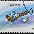 A stamp printed in Tanzania shows Low - Flying, attack aircraft - Foto Stock