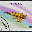 A stamp printed in Tanzania shows fighting bomber &amp;quot;Mirage 3NG&amp;quot; - Foto Stock