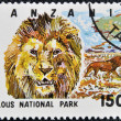 Stamp printed in Tanzania dedicated to selous national park, shows lion - Foto Stock