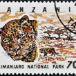 Stamp printed in Tanzania dedicated to Kilimanjaro national park, shows leopard - Foto Stock