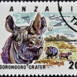 Stamp printed in Tanzania dedicated to Ngorongoro crater, shows rhinoceros - Foto Stock