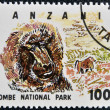 Stamp printed in Tanzania dedicated to Gombe National Park, shows baboon - Foto Stock