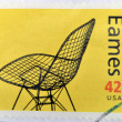 A stamp printed in USA shows eames chair - Foto Stock