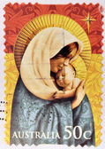 A Christmas stamp printed in Australia shows Madonna with child — Stock Photo