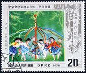 A stamp printed in DPR North Korea shows celebrating spring with May Pole — Stock Photo
