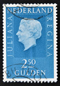 A stamp printed in the Netherlands showing a portrait of Queen Juliana — Stock Photo