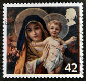 A stamp printed in the United Kingdom shows The Virgin mary with Infant Christ — Stock Photo