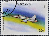 Un francobollo stampato in tanzania illustrato tactical fighter jet f-50 — Foto Stock