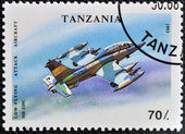 A stamp printed in Tanzania shows Low - Flying, attack aircraft — Stockfoto
